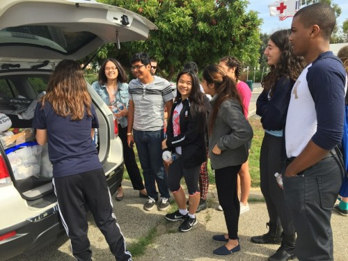 Youth members check out a Red Cross disaster response vehicle .