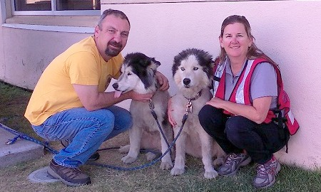 Scott and Wendy with their Huskies.