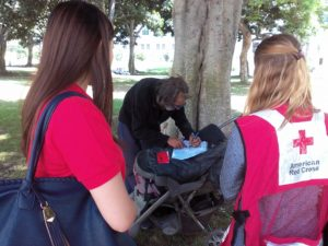 Red Cross client writes a letter to his sister, which will be delivered through the Cuban Red Cross.
